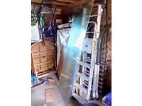 1960's solid glass internal door with hinges and handle.