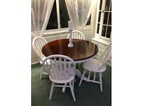 Round Extendible dining table with four chairs