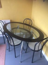 Oval glass table & chairs