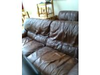 Free brown leather settee