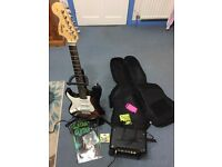 Strat Squier Fender Electric Guitar (LEFT HANDED) with Marshall amp, stand, bag & tuner