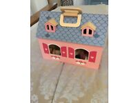 Wooden carry along dolls house