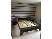 KINGSIZE SPRING BED 2 BEDSIDE TABLES AND WICKER CHAIR