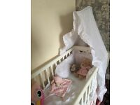 Baby swinging crib and Broderie Anglaise bedding