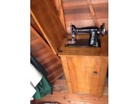 Classic sewing machine and wooden cabinet for sale