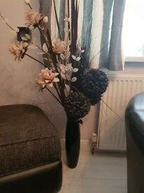 Artificial flowers and vase