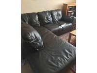 DFS dark brown/black leather corner sofa, armchair and footstool