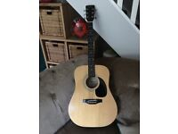 Acoustic guitar with gig case