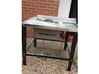 Table saw with spare blades