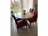 Round oak table and 4 leather chairs