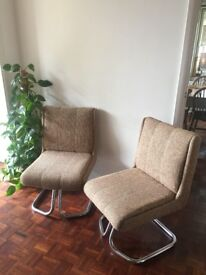 A pair of unique and stylish retro chairs.