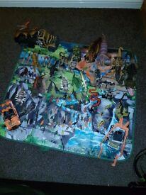 ELC Dinosaur bundle, storage box / mat, vehicles. 83 pieces