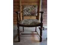 Solid oak 1930 carved openarm dining chair