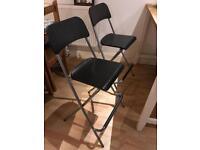 Two Ikea black bar stools