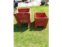2 very well made planter boxes ceder red in colour