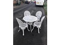 Lovely cast iron garden table and 4 chairs bargain £90 free delivery