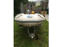 Inflateable dinghy + outboard + trailer