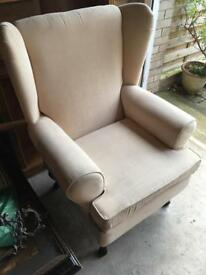 Wing back cream armchair