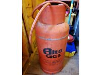 19kg Propane gas bottle, over half full.
