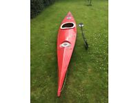 Sea Kayak with paddle