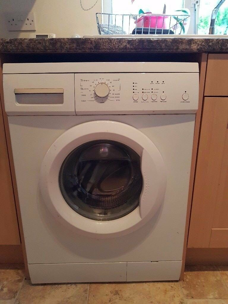 Essential washing machine, needs repairing or use for parts.