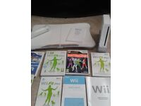 WII FIT PLUS INCLUDING BALANCE BOARD AND VARIOUS GAMES.
