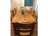 Beautiful solid oak extending dining table and 8 matching chairs