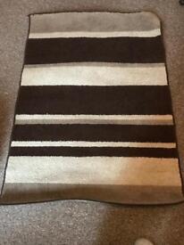 Brown and beige rug