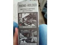 Smartphone case holder for motorbike with sun and rain protector.