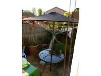 Garden table and umbrella