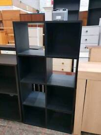 Black cubed shelving with available delivery