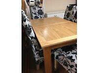Oak dining table and six black and grey chairs £750 set