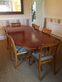 Yew Dining room table, chairs, display case and bookcase.