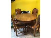 4 seater wooden round table and chairs