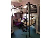Metal high sleeper bed including mattress.