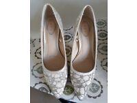 Ivory heels size 5
