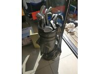 Golf clubs, bag with balls and tees