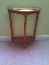 Hall table, half round, three legs.