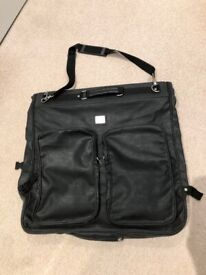 Pierre Cardin Suit Carrier with several pockets and hanger