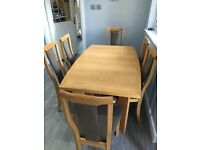 Pale oak dining room table with 6 chairs