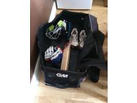 Cricket Gear inc Helmet, Shirts x2, gloves, shoes and bag.