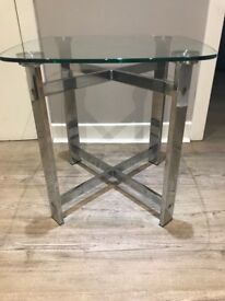 Two solid glass side tabels