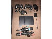 Sony PlayStation 2 console with games and SingStar mics