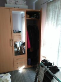 3 door wardrobe with 3 drawers and an internal top shelf