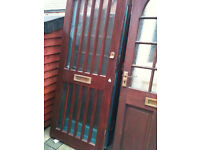 Exterior hardwood door with frosted glass strips