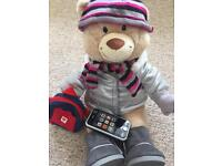 Build a Bear with coat, boots,phone , rucksack