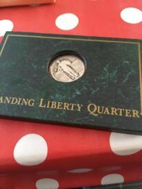 Standing liberty quarter dollar in silver