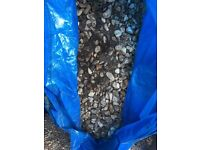FREE bags of small stone/pebbles and soil mix