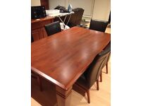 Malaysian oak dining table with leather chairs and buffet unit