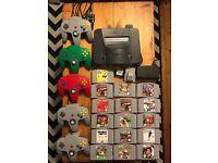 Nintendo 64 console + 16 games including Super Mario 64, Mario Karts & Goldeneye + 5 controllers
